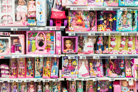 barbie: BUCHAREST, ROMANIA - FEBRUARY 28, 2015: Barbie Toys For Girls And Other Baby Toys On Supermarket Stand. Editorial