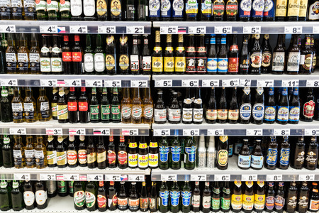 BUCHAREST, ROMANIA - FEBRUARY 28, 2015: Alcohol Bottles For Sale On Supermarket Stand.