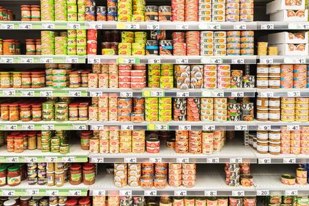 canned food: BUCHAREST, ROMANIA - MARCH 01, 2015: Canned Food On Supermarket Stand.