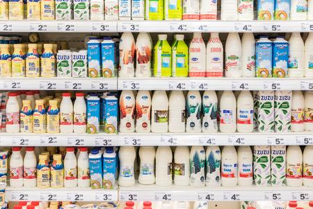 dairy products: BUCHAREST, ROMANIA - MARCH 01, 2015: Fresh Milk Bottles On Supermarket Stand.