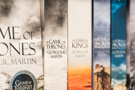 BUCHAREST, ROMANIA - MARCH 07, 2015: Game Of Thrones Books For Sale On Library Shelf. It is the first novel in a series of high fantasy novels by American author George R. R. Martin. Editorial