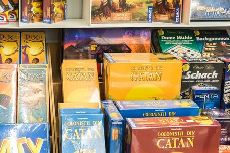BUCHAREST, ROMANIA - MARCH 22, 2015: Children Board Games For Sale On Library Shelf. Editorial