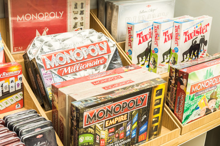 go inside: BUCHAREST, ROMANIA - MARCH 22, 2015: Monopoly Game For Sale On Library Shelf. Monopoly is a board game that originated in the United States in 1903 as a way to demonstrate the evils of land ownership