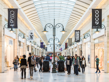 mall: BUCHAREST, ROMANIA - MARCH 30, 2015: People Shopping In Luxury Shopping Mall Interior.