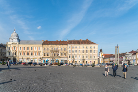 napoca: CLUJ NAPOCA, ROMANIA - APRIL13, 2015: Tourists Walking Downtown In The Old Center Of Cluj Napoca.