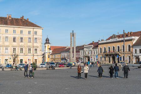 old center: CLUJ NAPOCA, ROMANIA - APRIL13, 2015: Tourists Walking Downtown In The Old Center Of Cluj Napoca.