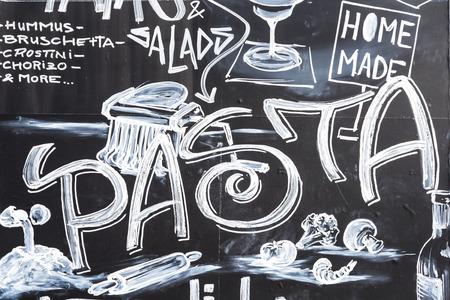 napoca: CLUJ NAPOCA, ROMANIA - APRIL 13, 2015: Restaurant Food Menu Design On Black Chalkboard At Local Restaurant In The Museum Square Of Cluj Napoca. Editorial