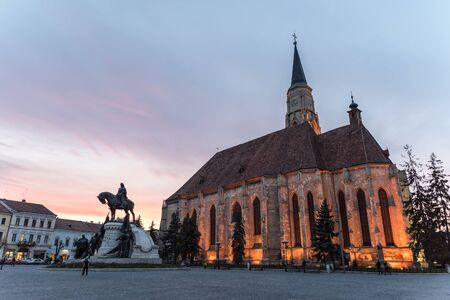 cluj: CLUJ NAPOCA, ROMANIA - APRIL 14, 2015: Sunset Blue Hour At Saint Michael Roman Catholic Church Built In Gothic Style In 1390.
