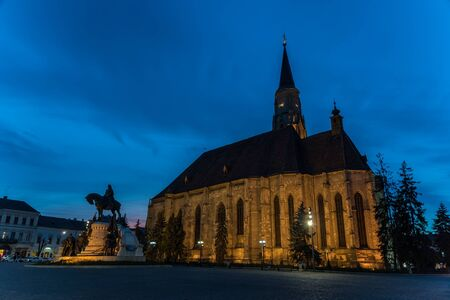 CLUJ NAPOCA, ROMANIA - APRIL 14, 2015: Sunset Blue Hour At Saint Michael Roman Catholic Church Built In Gothic Style In 1390.
