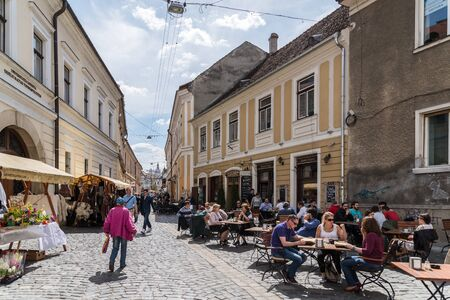 old center: CLUJ NAPOCA, ROMANIA - AUGUST 25, 2014: Tourists Walking Downtown In The Old Center Of Cluj Napoca.