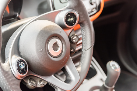 daimler: BUCHAREST, ROMANIA - APRIL 26, 2015: Smart Fortwo Interior View. It is a rear-engine, rear-wheel-drive, two-passenger, two-door city car manufactured by Smart division of Daimler AG. Editorial