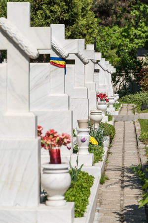 martiri: BUCHAREST ROMANIA  APRIL 28 2015: The Heroes Cemetery Cimitirul Eroilor Martiri was built after the 1989 revolution and here are buried people that died in the tragic events in december 1989.
