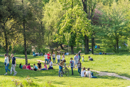 BUCHAREST ROMANIA  MAY 08 2015: People Having Picnic And Playing Games In Carol Public Park On Spring Day.