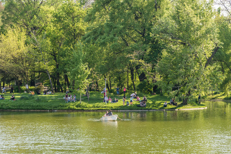 BUCHAREST ROMANIA  MAY 08 2015: People Boat Ride On Carol Public Park Lake On Spring Day.