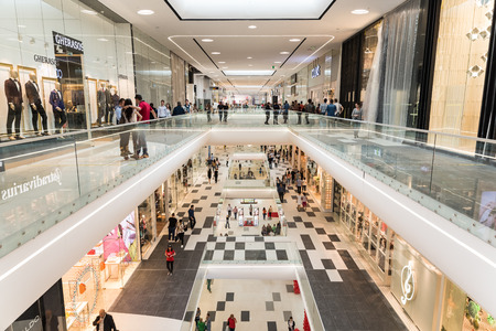 shopping mall interior: BUCHAREST ROMANIA  MAY 14 2015: People Shopping In Luxury Shopping Mall Interior.