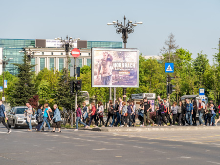 crossing street: BUCHAREST ROMANIA  MAY 14 2015: Crowd Of People Pedestrians Crossing Street In Union Square Piata Unirii Downtown Of Bucharest City. Editorial