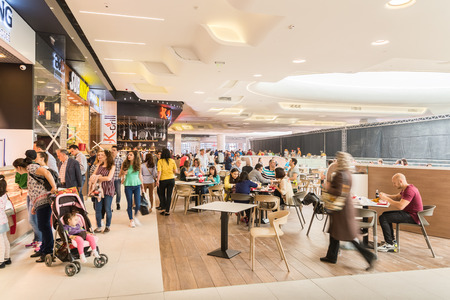 shopping mall interior: BUCHAREST ROMANIA  MAY 15 2015: People Eating At Restaurant In Luxury Shopping Mall Interior.