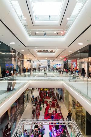 shopping mall interior: BUCHAREST ROMANIA  MAY 16 2015: People Shopping In Luxury Shopping Mall Interior.