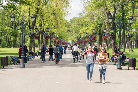 walk in: BUCHAREST ROMANIA  MAY 15 2015: People Taking A Walk On Hot Spring Day In Mogosoaia Public Park.
