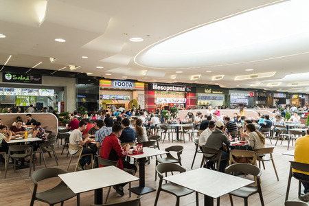 shopping mall interior: BUCHAREST ROMANIA  MAY 17 2015: People Eating At Restaurant In Luxury Shopping Mall Interior. Editorial