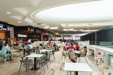 people eating: BUCHAREST ROMANIA  MAY 17 2015: People Eating At Restaurant In Luxury Shopping Mall Interior. Editorial