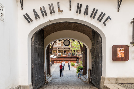 housed: BUCHAREST ROMANIA  MAY 17 2015: Manucs Inn Hanul lui Manuc built in 1808 is the oldest hotel building in Bucharest and it also housed a popular restaurant several bars and a coffeehouse. Editorial