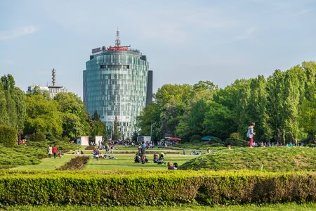 headquartered: BUCHAREST ROMANIA  MAY 24 2015: Vodafone Building viewed from park Herastrau is the secondlargest mobile telecommunications company headquartered in London. Editorial