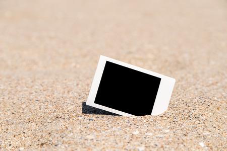 blank photo: Blank Retro Instant Photo On Beach Sand In Summer Stock Photo