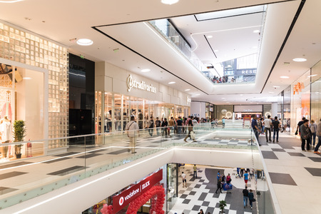 BUCHAREST ROMANIA  JUNE 01 2015: People Crowd Shopping In Luxury Mall Interior.