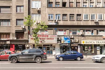city traffic: BUCHAREST ROMANIA  JUNE 03 2015: Rush Hour Traffic In Downtown Roman Square Piata Romana Of Bucharest City.