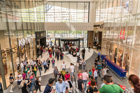 BUCHAREST ROMANIA  JUNE 05 2015: People Crowd Shopping In Luxury Mall Interior.