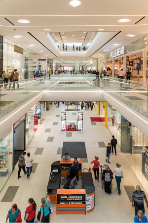 shopping mall interior: BUCHAREST ROMANIA  JUNE 06 2015: Shoppers Rush In Luxury Shopping Mall Interior.