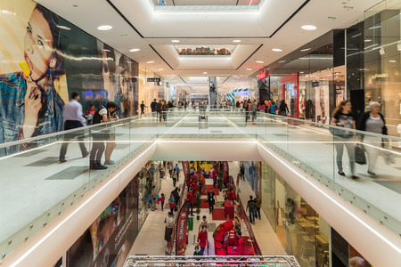 shop interior: BUCHAREST ROMANIA  JUNE 06 2015: Shoppers Rush In Luxury Shopping Mall Interior.