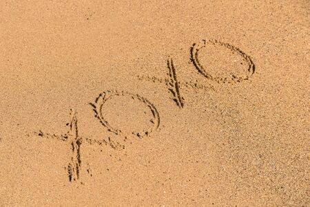 xoxo: Hugs And Kisses XOXO Sign On Beach Sand
