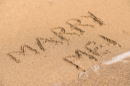 valentine married: Marry Me Word Written On Sunny Summer Beach Sand Stock Photo