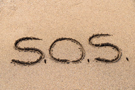 SOS Help Cry For Help Written On Beach Sand Stock Photo - 41847891