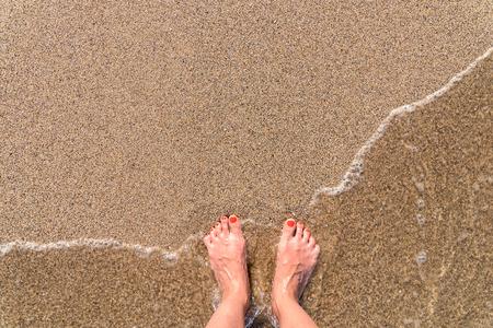 Ocean Sea Waves And Girl Feet On Summer Sand Beach