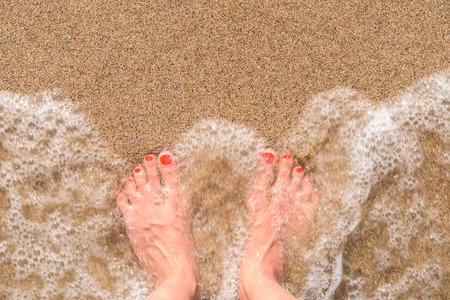 ocean and sea: Ocean Sea Waves And Girl Feet On Summer Sand Beach