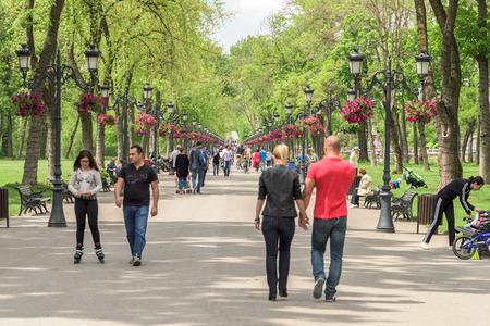 walk in: BUCHAREST, ROMANIA - JULY 06, 2015: People Taking A Walk On Hot Summer Day In Mogosoaia Public Park.