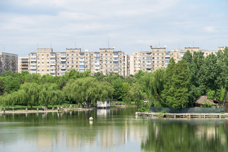 apartment blocks: BUCHAREST , ROMANIA - JULY 06, 2015: Bucharest Communist Apartment Blocks Skyline View From Tineretului Park. Editorial