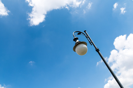 Vintage Street Light Pole Against Blue Sky Stock Photo