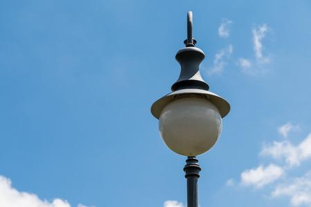 streetlights: Vintage Street Light Pole Against Blue Sky Stock Photo