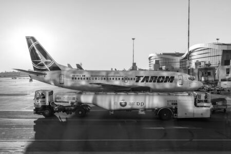 coanda: BUCHAREST, ROMANIA - AUGUST 03, 2015: Tarom Airplane Landing On Bucharest Henri Coanda Otopeni International Airport.