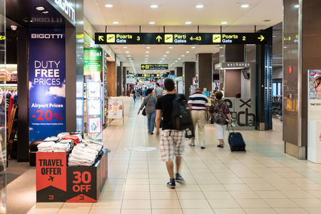 henri: BUCHAREST, ROMANIA - AUGUST 03, 2015: Passengers In Bucharest Henri Coanda Otopeni International Airport.