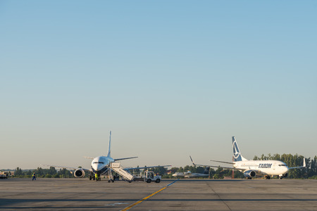 coanda: BUCHAREST, ROMANIA - AUGUST 03, 2015: Airplanes On Bucharest Henri Coanda Otopeni International Airport.