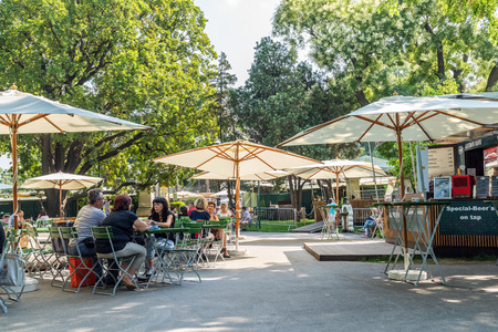 VIENNA, AUSTRIA - AUGUST 05, 2015: Tourists Visiting And Having Lunch At Outdoor Restaurant Cafe Downtown Vienna City.