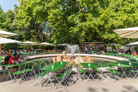 having lunch: VIENNA, AUSTRIA - AUGUST 05, 2015: Tourists Visiting And Having Lunch At Outdoor Restaurant Cafe Downtown Vienna City.