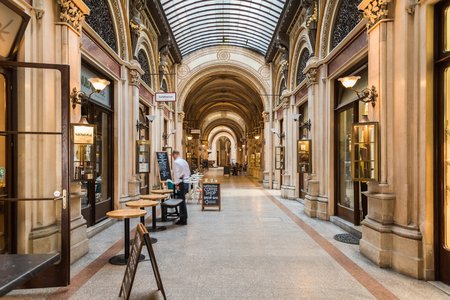 housed: VIENNA, AUSTRIA - AUGUST 09, 2015: Palais Ferstel originally housed the Austro-Hungarian National Bank and the Stock Exchange as well as bazaar and a cafe popular with artists and men of letters.