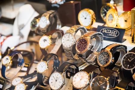 shop window display: VIENNA, AUSTRIA - AUGUST 10, 2015: Luxury Watches For Sale In Shop Window Display. Editorial