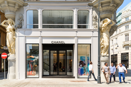 specializes: VIENNA, AUSTRIA - AUGUST 15, 2015: Chanel is a high french fashion house that specializes in haute couture and ready-to-wear clothes, luxury goods and fashion accessories.
